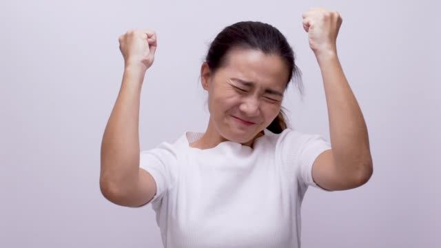 woman excited on white background slow motion - waist up stock videos & royalty-free footage