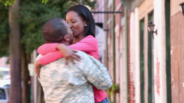 ms woman excitedly hugging soldier returning home from military service / petersburg, virginia, united states - homecoming stock videos & royalty-free footage