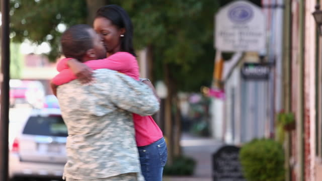 ws woman excitedly hugging soldier returning home from military service / petersburg, virginia, united states - 歩兵点の映像素材/bロール