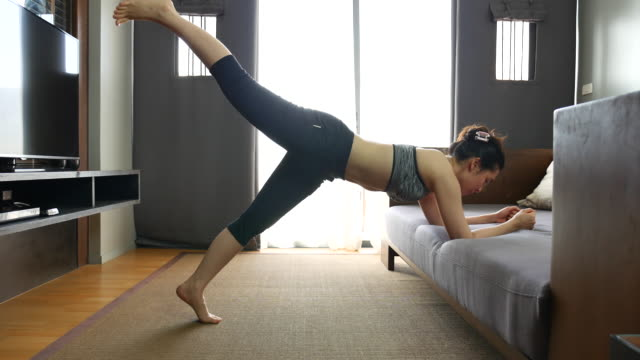 woman exercise at home - yoga stock videos & royalty-free footage