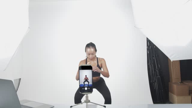 woman exercise, teach online to social media via mobile phone in studio - camcorder stock videos & royalty-free footage