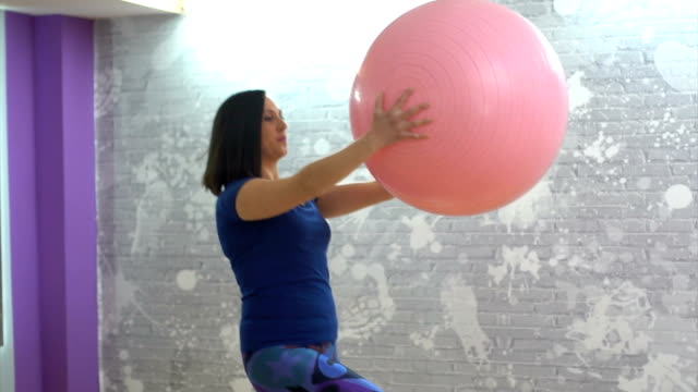 woman exercises with fitness ball - fitness ball stock videos & royalty-free footage