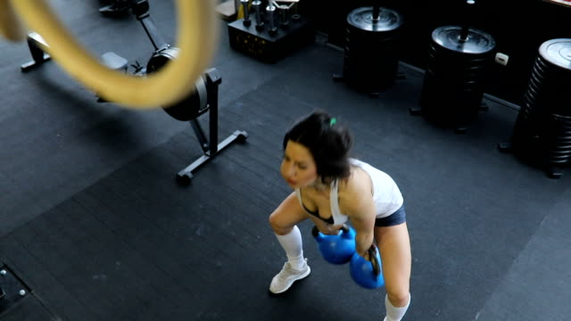 woman exercises with kettlebells - kettlebell stock videos & royalty-free footage