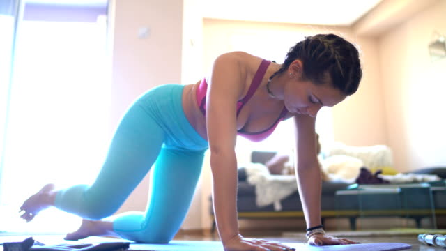 woman exercising at home - bra stock videos & royalty-free footage