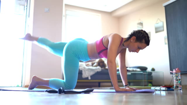 woman exercising at home - exercise mat stock videos & royalty-free footage