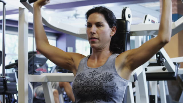 ms woman exercising in gym / draper, utah, usa - maglietta senza maniche video stock e b–roll