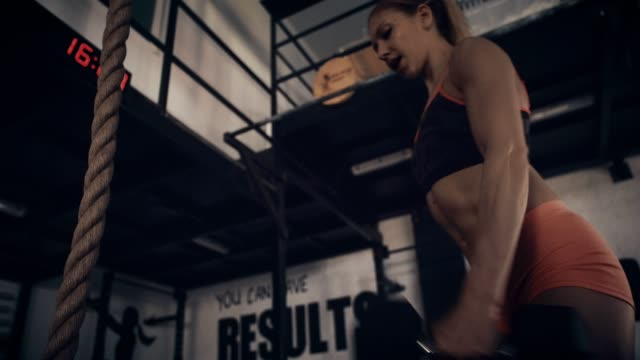 woman exercising in gym - low angle view - self improvement stock videos & royalty-free footage
