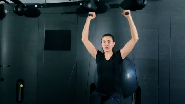 woman exercising on cable crossover in gym - pilates stock videos and b-roll footage