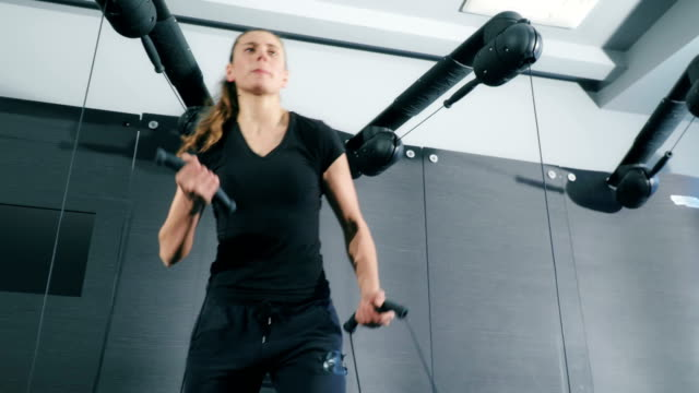 woman exercising on cable crossover in gym - bicep stock videos & royalty-free footage
