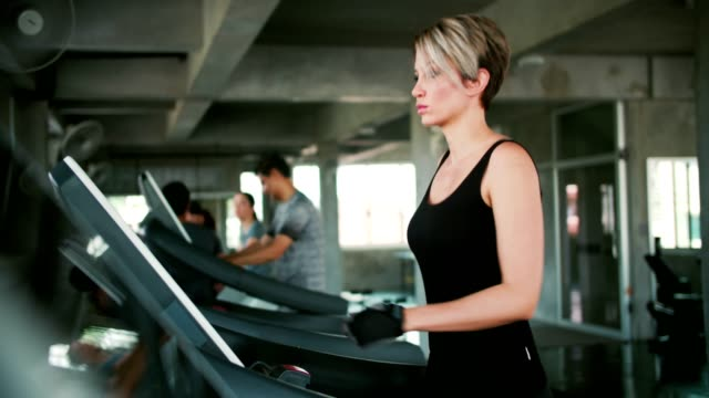 woman exercising on treadmill - overweight women stock videos & royalty-free footage