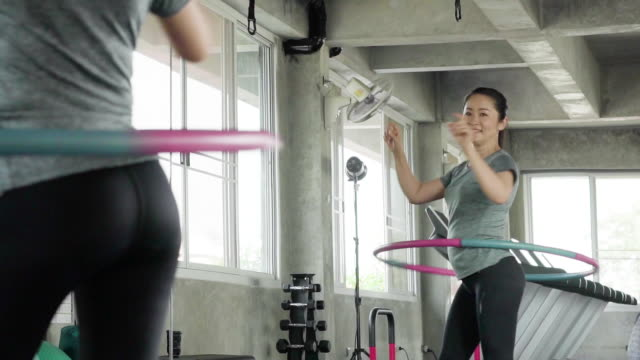 woman exercising with a hula hoop in gym - plastic hoop stock videos & royalty-free footage