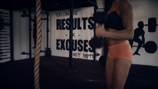 woman exercising with dumbbells - mid section - self improvement stock videos & royalty-free footage