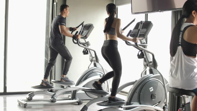 woman exercising with friend in gym - cross trainer stock videos and b-roll footage