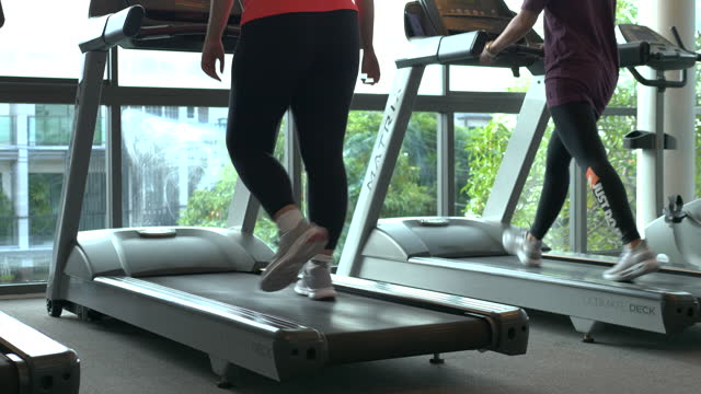 woman exercising with friend in gym - cross trainer stock videos & royalty-free footage