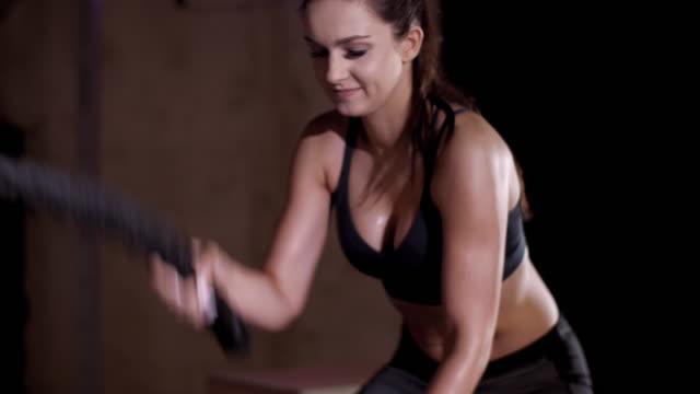 woman exercising with ropes/ mielec/ poland - podkarpackie voivodeship video stock e b–roll