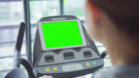 woman exercising workout at gym and looking digital tablet,green screen - treadmill stock videos & royalty-free footage
