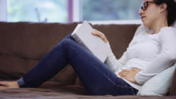 Woman experiencing pain while reading
