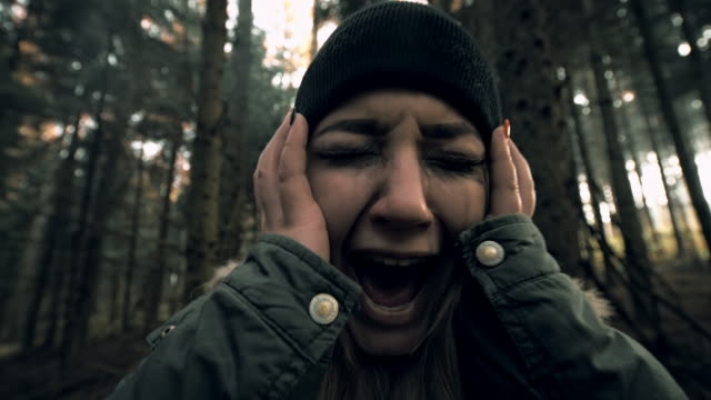 woman experiencing panic attack in the forest - fear stock videos & royalty-free footage