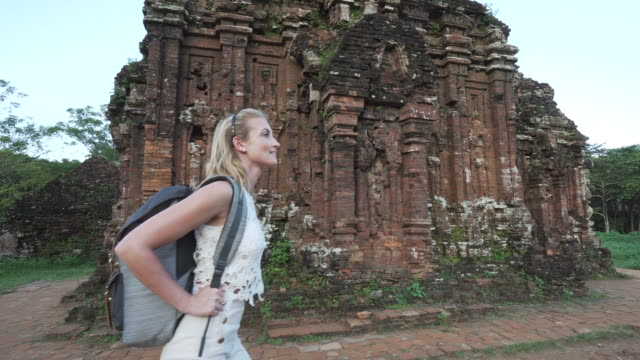 woman explores temple - rucksack stock videos & royalty-free footage