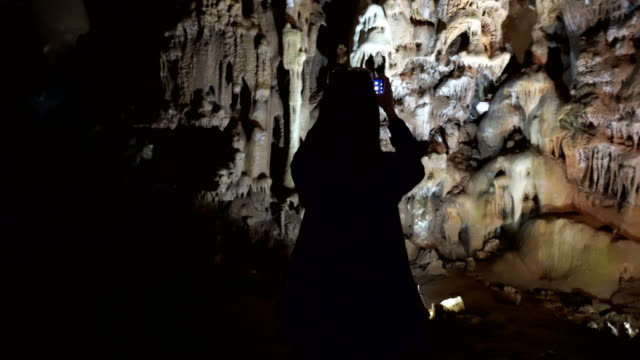 Woman explores the cave