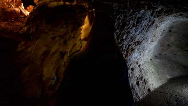 woman explores the cave - speleology stock videos and b-roll footage