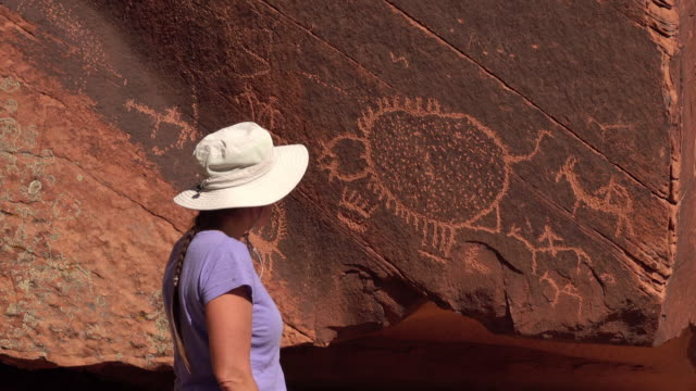 woman explores ute native american petroglyphs dominguez canyon wilderness colorado - indigenous north american culture stock videos and b-roll footage