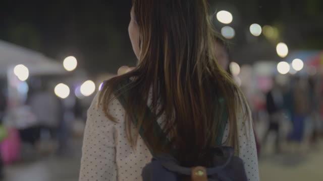 Woman exploring city night life
