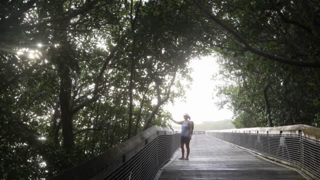 vídeos de stock e filmes b-roll de ws woman exploring in nature park. - só mulheres de idade mediana
