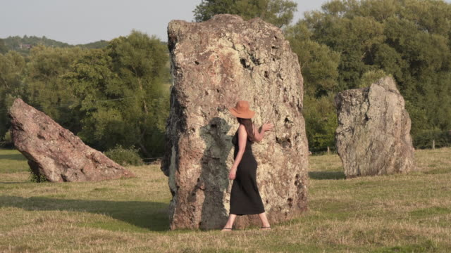 a woman exploring the ancient megalith stones at the stanton drew stone circle - obelisk stock videos & royalty-free footage
