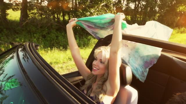 woman expresses joy - convertible stock videos & royalty-free footage