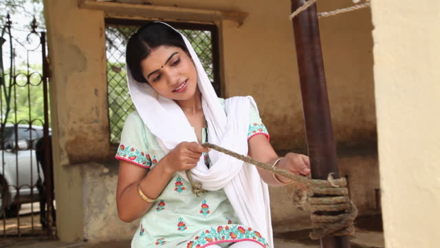 woman extracting butter, faridabad, haryana, india  - butter stock videos and b-roll footage