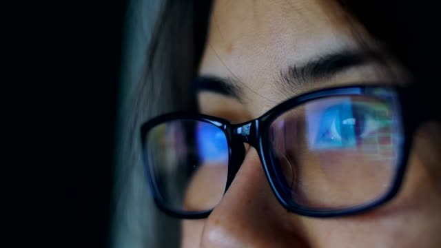 woman eye looking monitor, surfing internet - eyeglasses stock videos & royalty-free footage