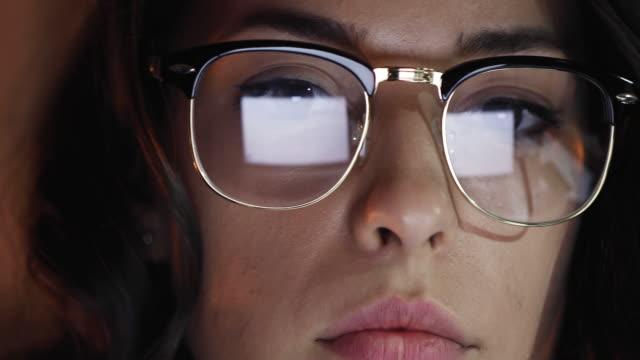woman eyeglasses reflecting laptop screen - lens eye stock videos & royalty-free footage