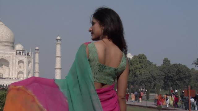 slo mo, ms, pan, woman facing taj mahal, rear view, agra, uttar pradesh, india - onion dome stock videos and b-roll footage