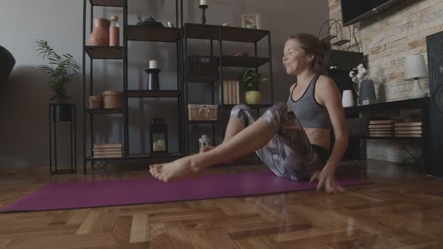 woman failing a straddle press pose while practicing yoga - failure stock videos & royalty-free footage