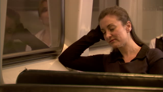 CU, Woman falling asleep in train, Sydney, Australia