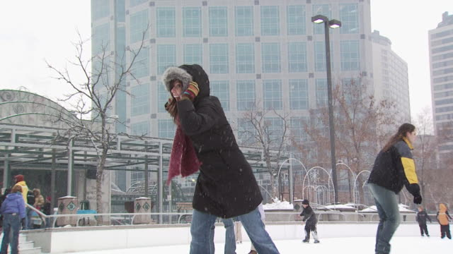 a woman falling at a busy ice rink - see other clips from this shoot 1145 stock videos & royalty-free footage