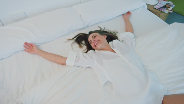 Woman falling in bed