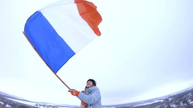 woman fan waving france flag - french flag stock videos & royalty-free footage