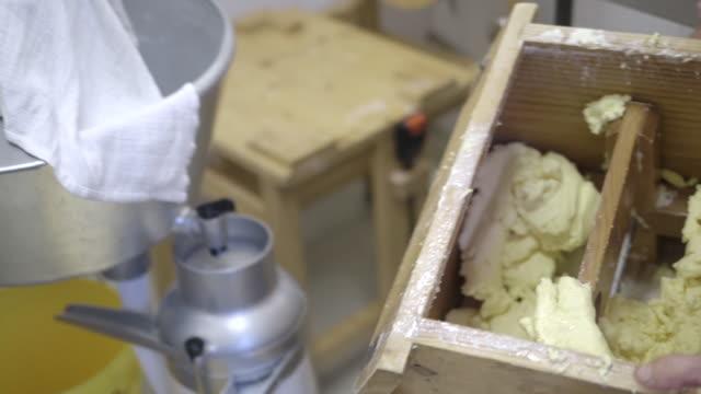 Woman Farmer making butter with butter churn
