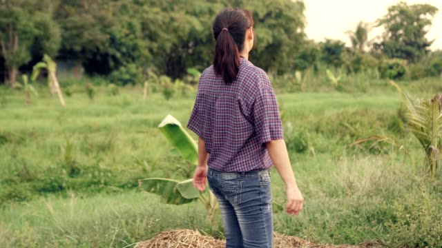 woman farmer walking in farm looking around