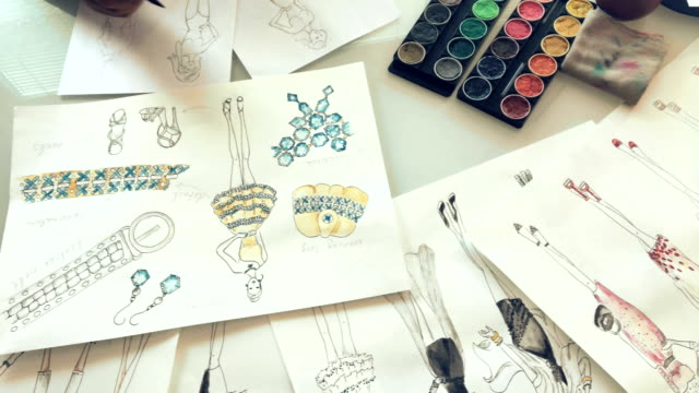Woman Fashion Designer Drawing Ideas and Sketches Indoors