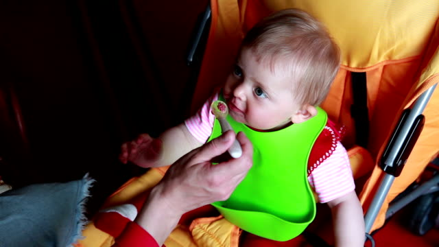 woman feeding a baby in the pram - leftovers stock videos & royalty-free footage