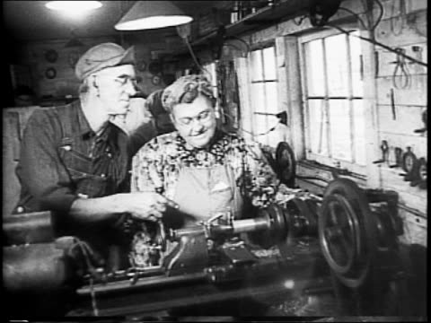 woman feeding chickens / farmer milking cow / mr and mrs john harrington have turned farm house into a factory / montage of family producing small... - altmetall stock-videos und b-roll-filmmaterial