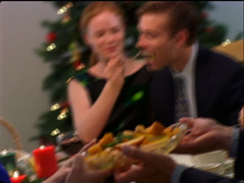 stockvideo's en b-roll-footage met canted pan woman feeding man at dining room table / christmas - dining room