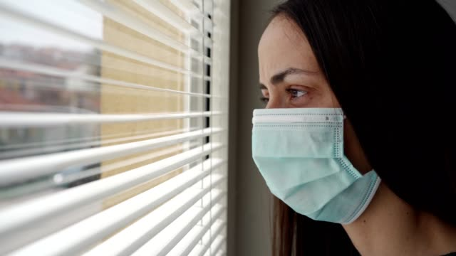 woman feeling lonely during coronavirus epidemic - quarantena video stock e b–roll