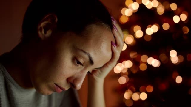 vídeos de stock e filmes b-roll de woman feeling sad at christmas holiday - deceção
