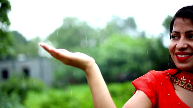 woman feels raindrops on palm of hand - teenagers only stock videos & royalty-free footage