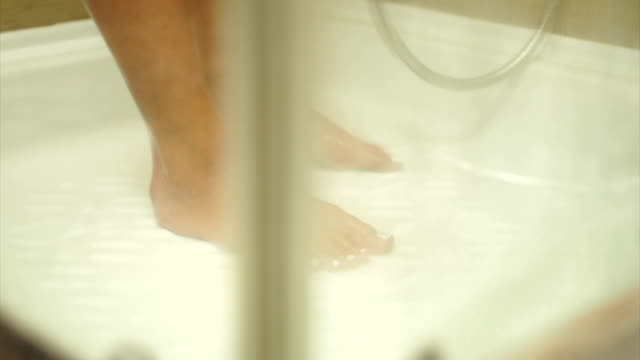woman feet in shower close up - shower head stock videos & royalty-free footage