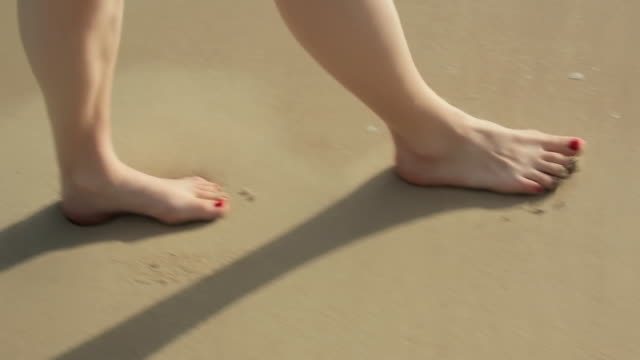 CU POV Woman feet walking on Caribbean beach / English Harbor, Antigua and Barbuda